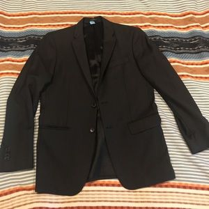 Designer black blazer w/ subtle vertical stripes
